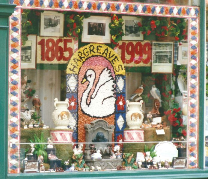 Buxton 1999 - Decorated Shop Window with Well Dressing